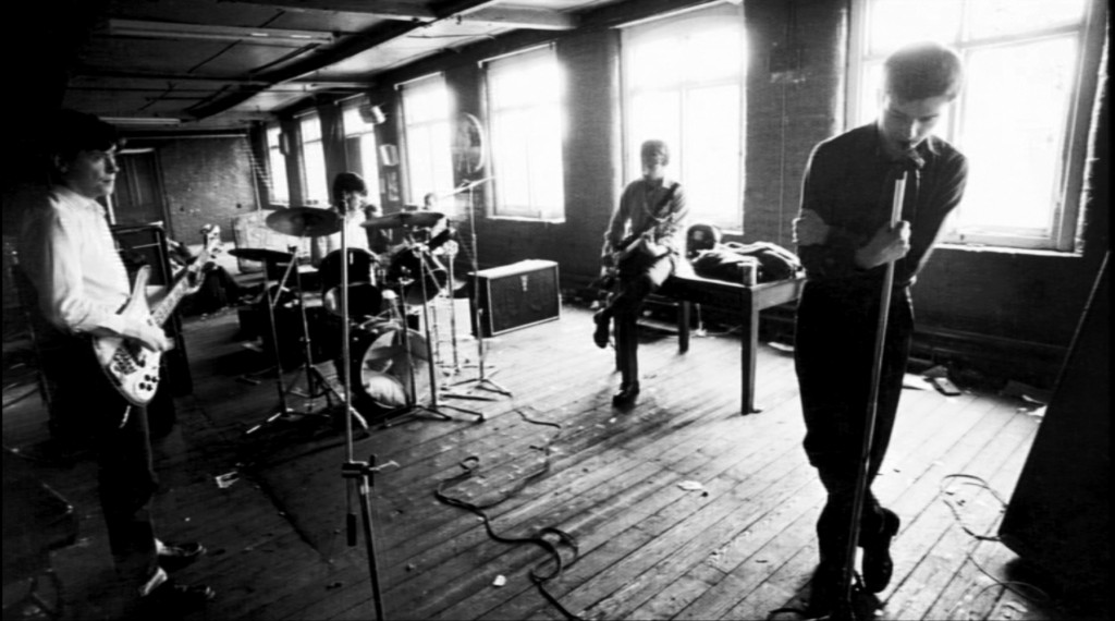 "Joy Division filming the music video for ""Love Will Tear Us Apart,"" 1980."