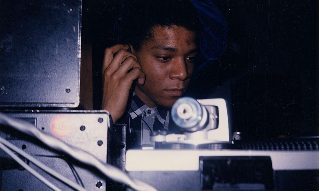 Jean-Michel Basquiat DJ-ing in the lounge at Area, 1986. Photograph by and courtesy of Johnny Dynell.