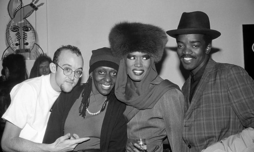 "(Left to right) Keith Haring, Bethany Hardison, Grace Jones, Fred ""Fab 5 Freddy"" Brathwaite at the Fun Gallery, ca. 1983. Photograph by and courtesy of Ande Whyland."