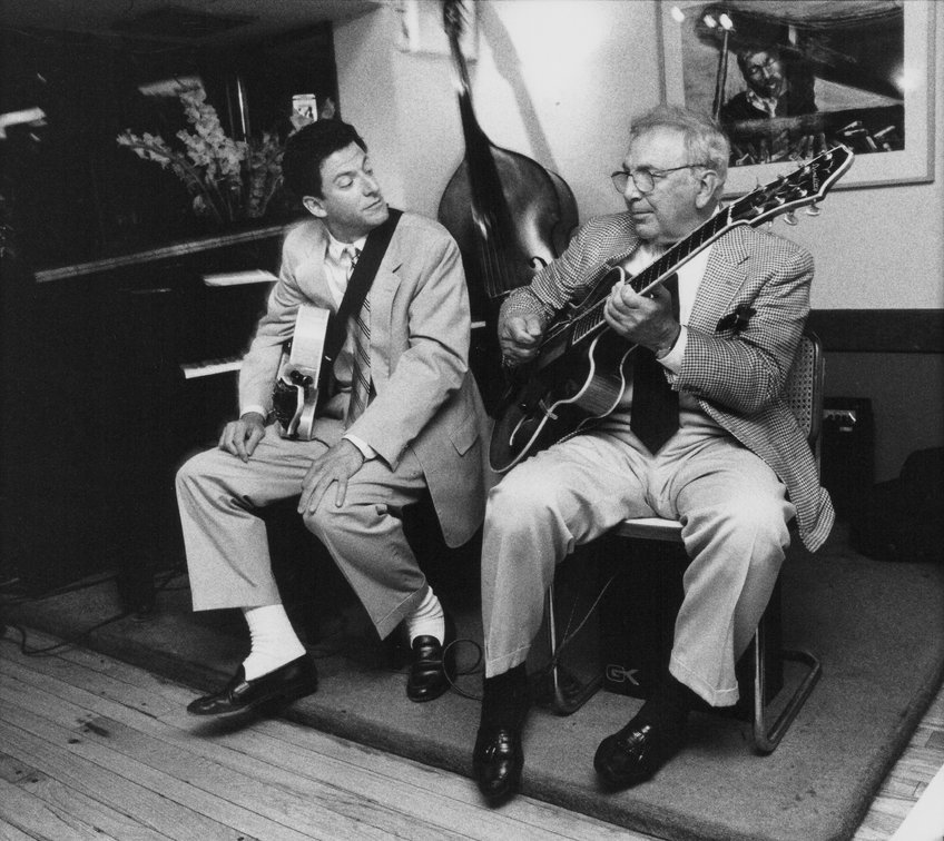 Bucky (right) and John Pizzarelli in 1997. Credit: Ebet Roberts/Redferns/Getty Images.